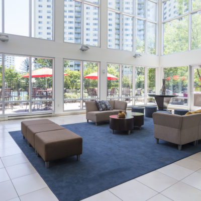 Enclave Apartments office lounge near a swimming pool
