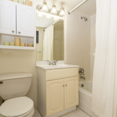 Bathroom in a Silver Spring high rise apartment in MD with white floor tiles