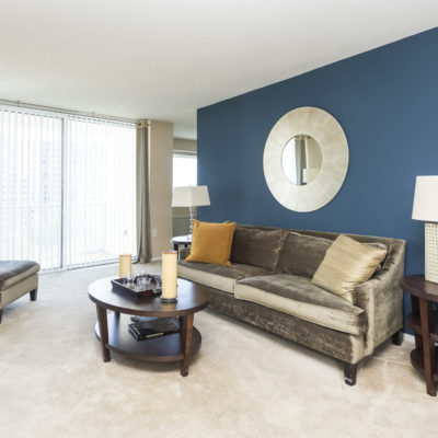 A blue accent wall inside an apartment at the Enclave Apartments
