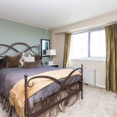 A cozy apartment bedroom at the Enclave in Silver Spring