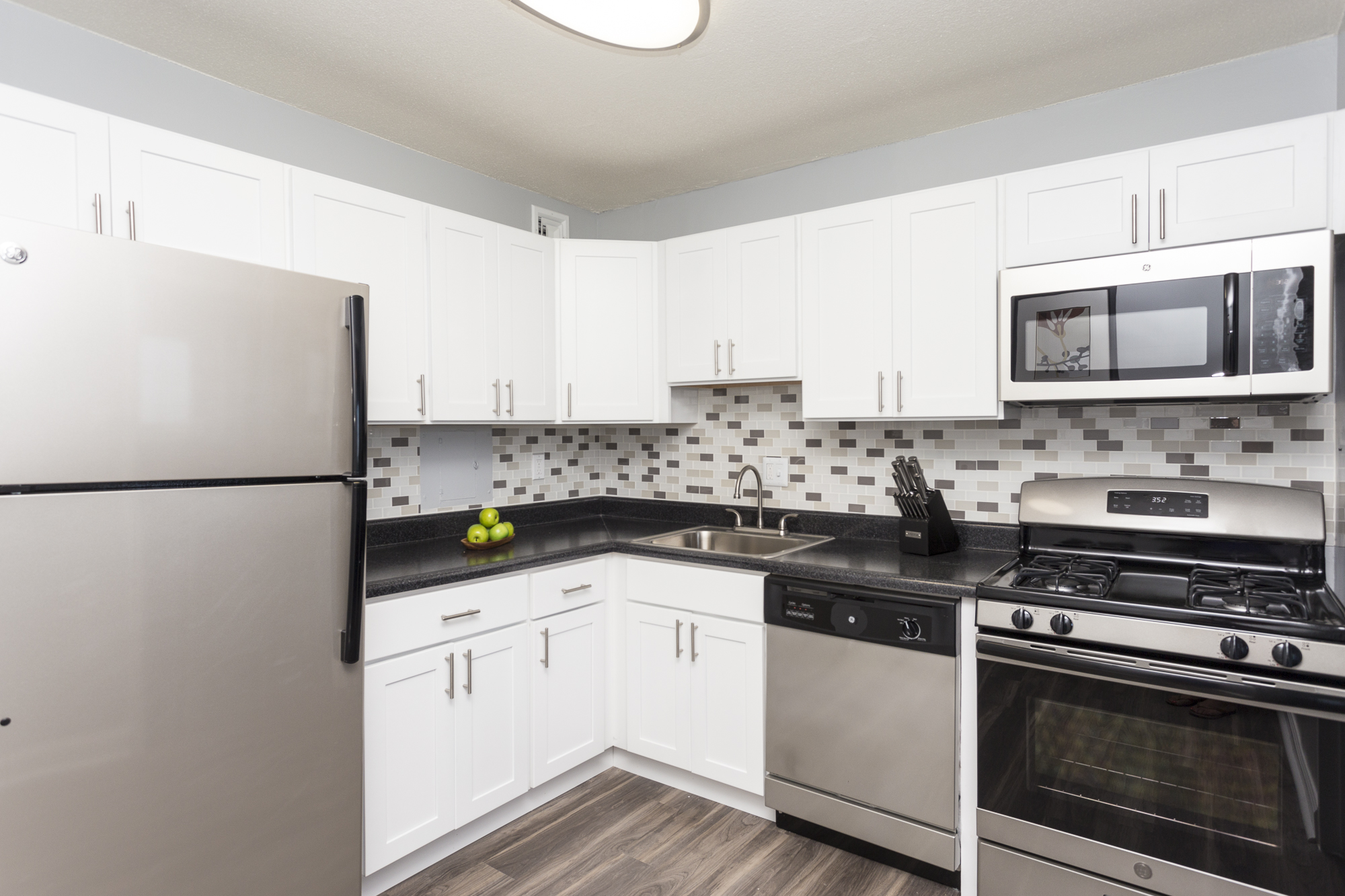 Grey backsplash in an updated kitchen at the Enclave Apartments