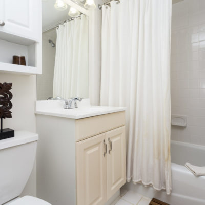 A luxurious bathroom with a soaking tub at the Enclave Apartments