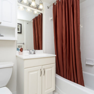 Bathrooms at the Enclave in Silver Spring with red curtains