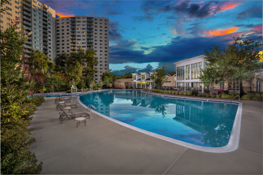 Enclave apartment tower and pool in Silver Spring MD at dusk