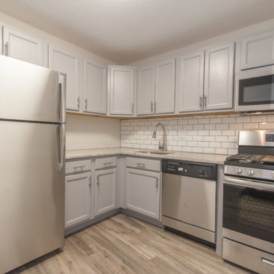 Luxury apartment kitchen with stainless steel appliances in Silver Spring MD